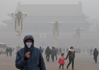 A man wears a mask on Tiananmen Square to combat thick haze in Beijing. China's air pollution problems have worsened over the past several years.