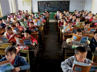 Elementary students in China's Sichuan Province read and recite from standardized textbooks