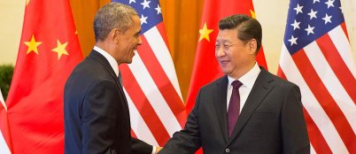 U.S. President Obama and Chinese President Xi Jinping at the 2014 APEC summit, where the two leaders announced a joint initiative to stop emissions growth by 2030.